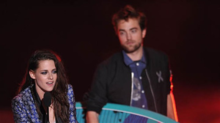 Kristen Stewart and Robert Pattinson Kristen Stewart and Robert Pattinson accepted the award for Ultimate Choice at the Teen Choice Awards on July 22.