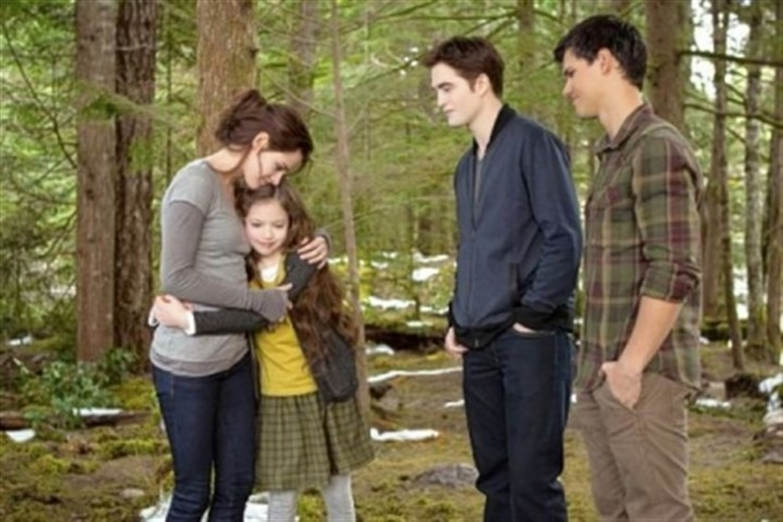 "Kristen Stewart, left, Mackenzie Foy, Robert Pattinson and Taylor Lautner Kristen Stewart, left, Mackenzie Foy, Robert Pattinson and Taylor Lautner close the door on ""Twilight"" in the film finale ""The Twilight Saga: Breaking Dawn -- Part 2."""