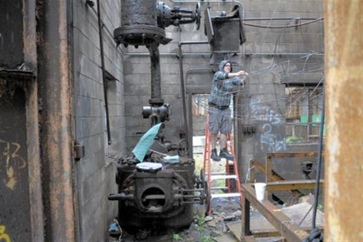"Kyla Groat Kyla Groat works on her artwork, ""My Lover, The Machine"" at the Carrie Furnaces."