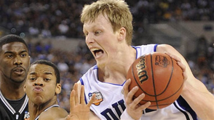 Kyle Singler and Ronald Nored Duke's Kyle Singler drives to the net against Butler's Ronald Nored in the first half.