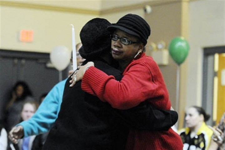 Lachoa Austin Lachoa Austin, left, of McKees Rocks comforts Carrol Dent of Youngstown, Ohio, the sister of Isaiah Dent, 61, during a memorial service.