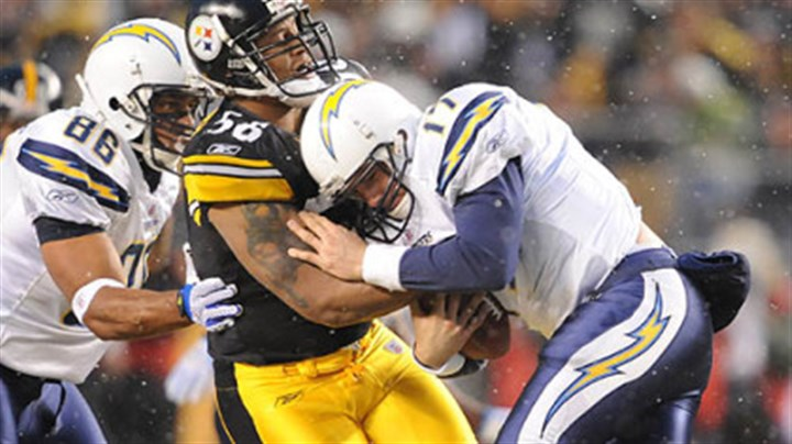 LaMarr Woodley LaMarr Woodley sacks Chargers quarterback Philip Rivers in the first quarter.