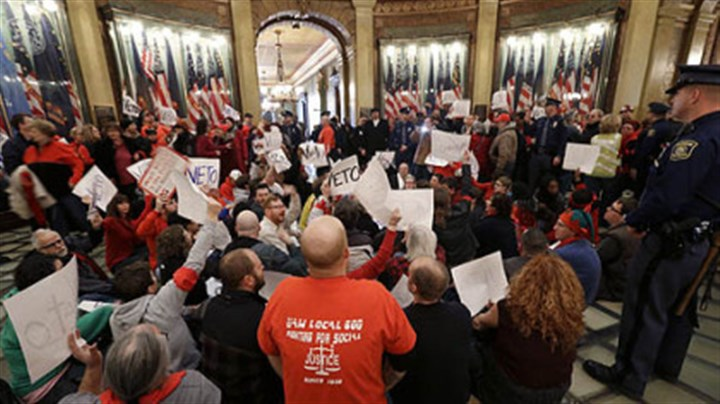 lansing protests Protesters sit in the rotunda of the State Capitol in Lansing, Mich., Tuesday, Dec. 11, 2012. The crowd is protesting right-to-work legislation passed last week.