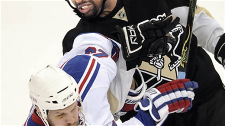 Laraque in action The Penguins' Georges Laraque gets tied up with the New York Rangers' Fredrik Sjostrom in a playoff game. 