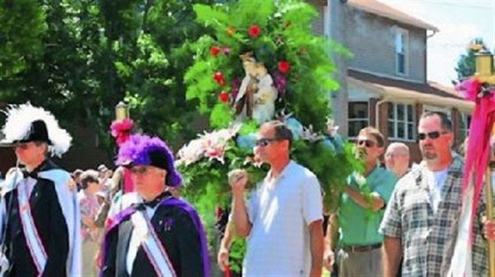 Last year Men carry the statue of Our Lady of Mount Carmel in the procession from St. Bartholomew Catholic Church in the 100th anniversary of the event last year.