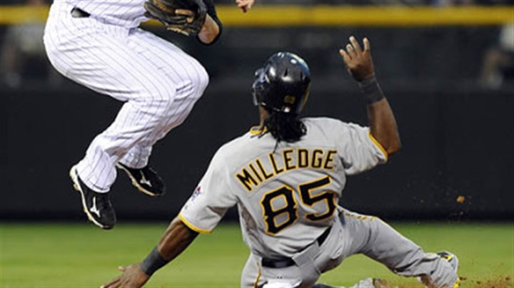 Lastings Milledge and Clint Barmes The Pirates' Lastings Milledge slides into second after being forced as Rockies second baseman Clint Barmes throws to first base to turn the double play on the Pirates' Ronny Cedeno in the sixth inning.