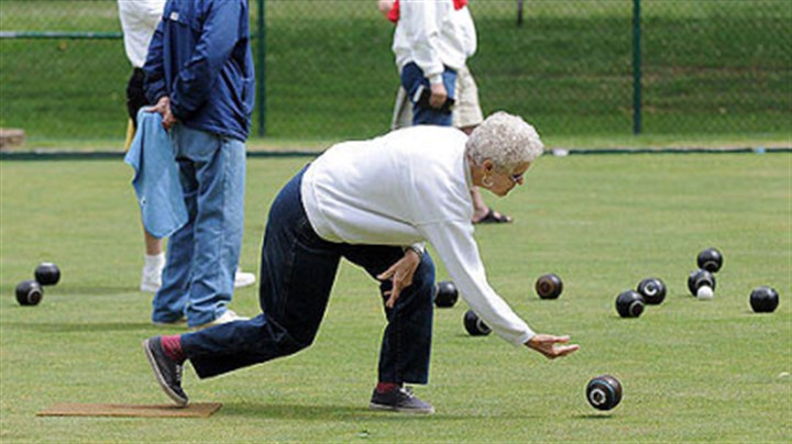 lawn bowling at Frick Park Helen Fickley of Penn Hills shows off her form during a lawn bowling match Tuesday at the public courts in Frick Park.
