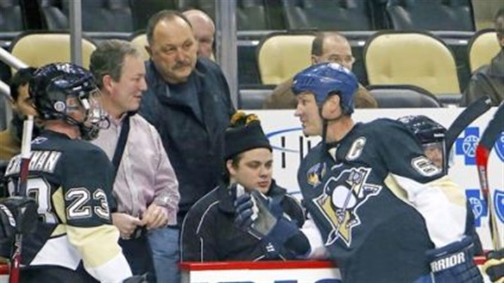 Lemieux.jpg Mario Lemieux, right, talks with Penguins general manager Ray Shero, second from left, before participating in the Mario Lemieux Fantasy Hockey Camp Monday at Consol Energy Center.