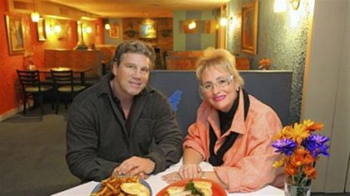 Lenny Radziewicz and Penny Folino Lenny Radziewicz and Penny Folino with their pretzel burger, left, and a Mediterranean platter at their restaurant, Center Plate.