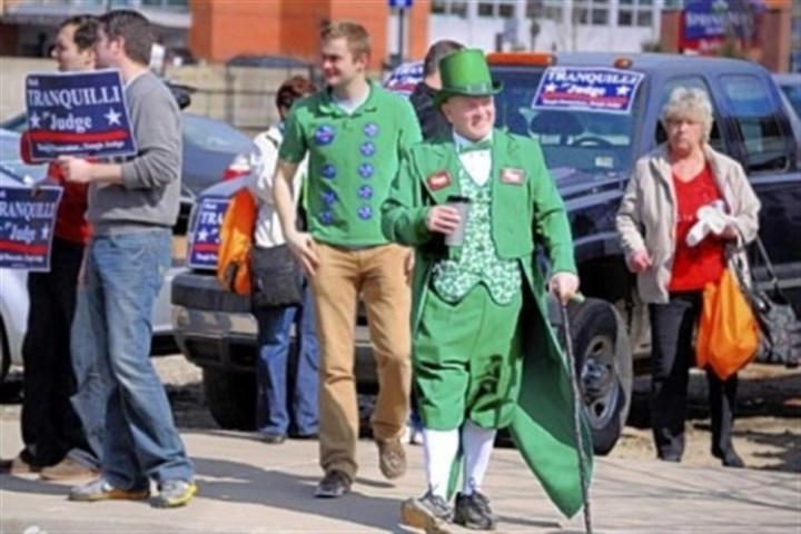 leprechaun Kevin Larkin of Verona sports a leprechan suit as he strolls through the crowd endorsing P.J. Murray for Common Pleas judge during the Allegheny County Democratic Committee's endorsement meeting, held Sunday afternoon at the IBEW building on the South Side.