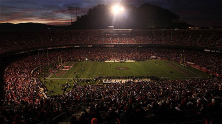 Lights Out! Candlestick Park is dimly lit during a power outage Monday before the game between the 49ers and Steelers in San Francisco.
