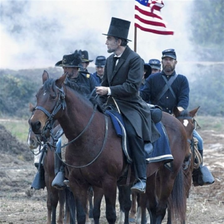 "'Lincoln' Daniel Day-Lewis as President Abraham Lincoln surveys a battlefield in the aftermath of a terrible siege in ""Lincoln."""