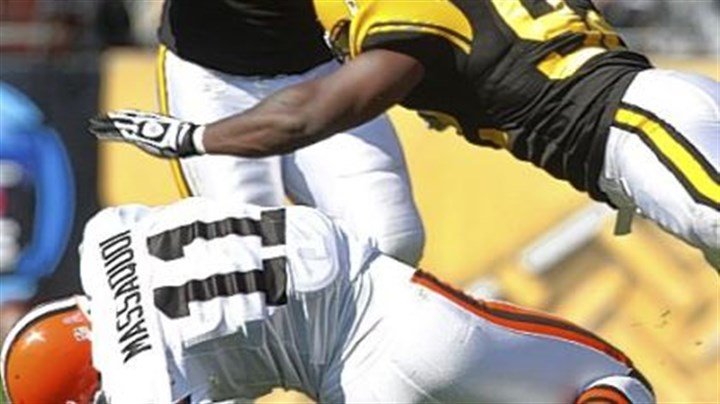 Linebacker James Harrison Linebacker James Harrison hits Browns wide receiver Mohamed Massaquoi. The NFL fined Harrison $75,000 for the hit.