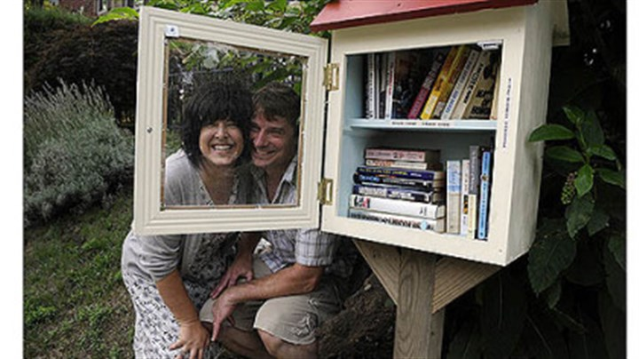 Lisa Ciccarelli and Rick McGee Lisa Ciccarelli and her husband, Rick McGee, with their Word House on Biddle Avenue in Regent Square. The Word House is a small free lending library where anyone can take a book after leaving one. The idea is part of a national trend, as found at www.freelibrary.org.