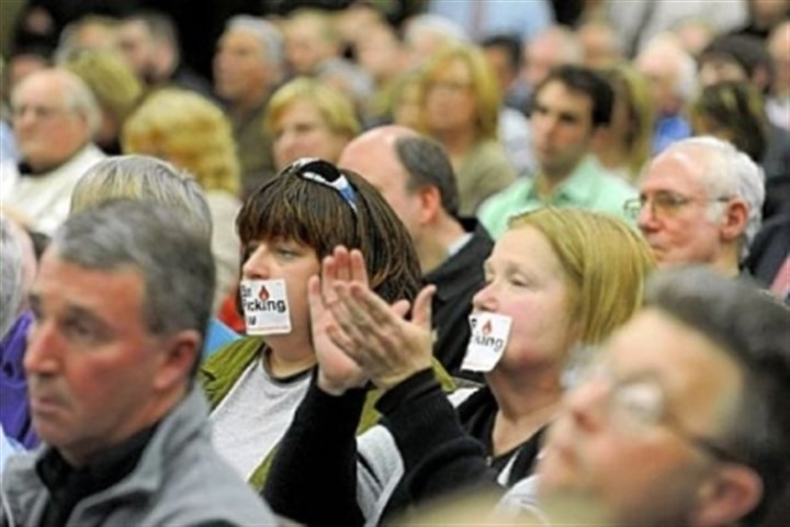 Lisa DeSantis and Maggie Henry Lisa DeSantis, left, of New Castle and Maggie Henry of Bessemer cover their mouths with Ban Fracking Now stickers during a hearing about the county's deal with Consol Energy to extract natural gas from land at Pittsburgh International Airport.