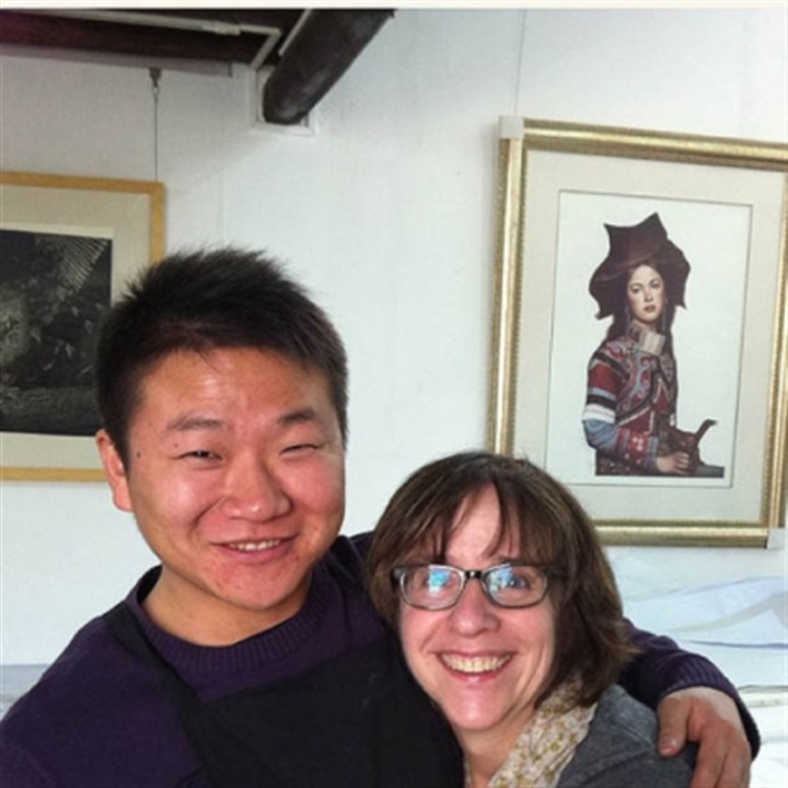 Liu Hongliang hugs Leslie Golomb Printmaker Liu Hongliang hugs Leslie Golomb of Point Breeze, who was an artist in residence for two months in Shenzhen, China, where she met and worked with Chinese artists at the Guanlan Printmaking Base.Printmaker Liu Hongliang hugs Leslie Golomb, a Point Breeze artist who was an artist in residence for two months in Shenzhen, where she met and worked with Chinese artists at the Guanlan Printmaking Base.
