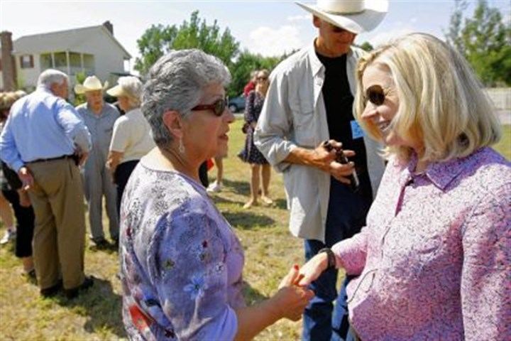 lizzzzzz Liz Cheney, right, gladhands at a Tea Party rally in Wyoming where she's running for the U.S. Senate.
