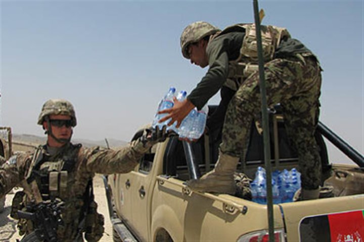 load water into trucks belonging to Afghan forces Lt. Dick Young helps load water into trucks belonging to Afghan forces during an operation in Nangarhar Province, where the Taliban and other militant groups continue to have strong influence in some villages.