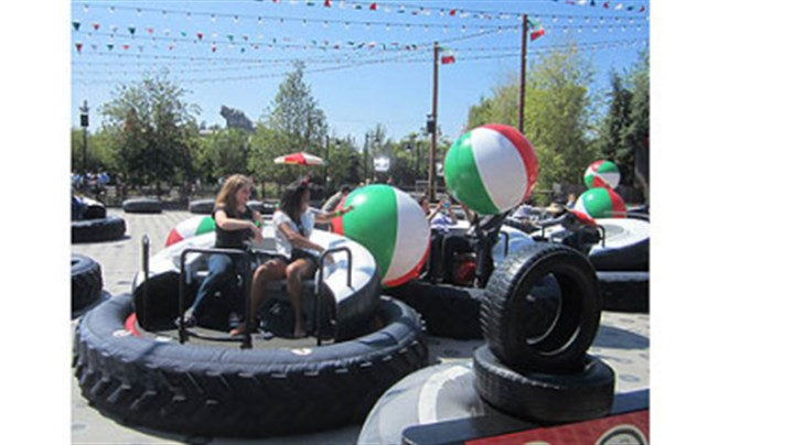 Luigi's Flying Tires At Luigi's Flying Tires at Disney California Adventure, riders sit atop giant tires and angle to grab giant beach balls to toss at other tire jockeys.