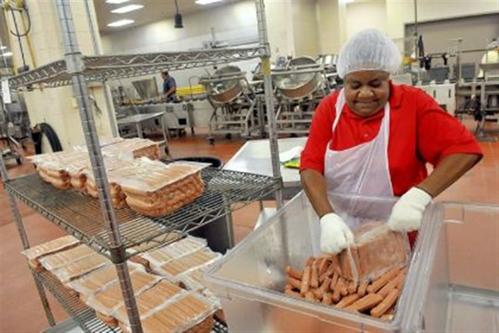 lunch 5 Darling Ladd breaks down packages of hot dogs at the Pittsburgh Public Schools' food processing facility on the South Side.
