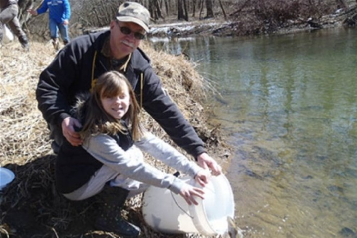 Makayla Boda, 9, and her grandfather Carl Dranzo Makayla Boda, 9, and her grandfather Carl Dranzo of Roscoe stock trout at Loyalhanna Creek.