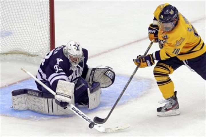 malcolm The stellar play of Yale goalie Jeff Malcolm was one of the highlights of the championship Saturday night.