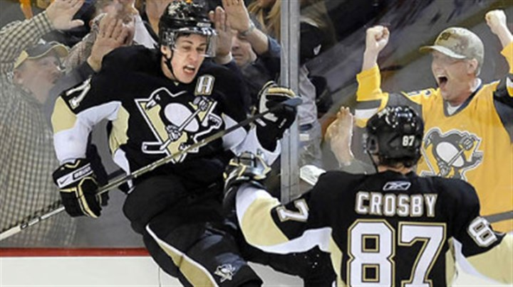Malkin and Crosby Evgeni Malkin celebrates his third-period game-tying goal with teammate Sidney Crosby.