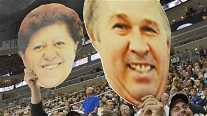 malkin parents heads Penguins fans hold up oversized cutouts of Vladimir and Natalia Malkin's heads during Game 1.