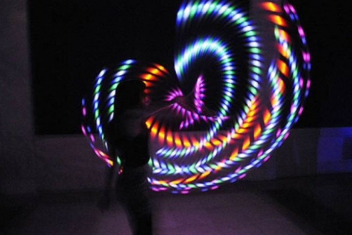 Mallory Sarver Mallory Sarver of Moon Township makes art using a lighted hula hoop, taken with a long camera exposure.