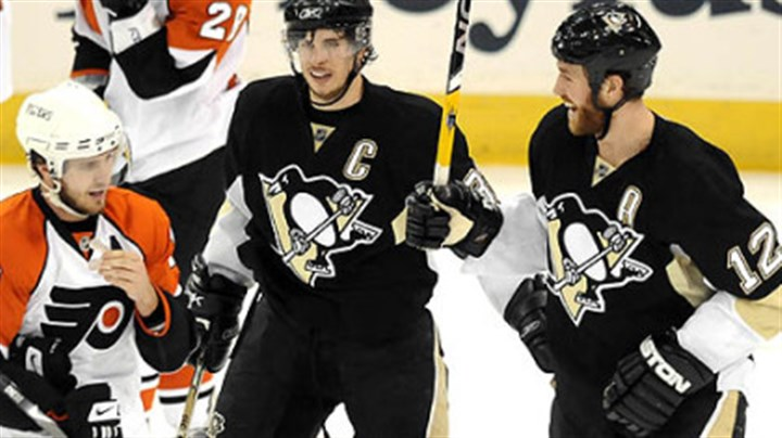 Malone Penguins Ryan Malone celebrates his second period goal with teammate Sidney Crosby Sunday.