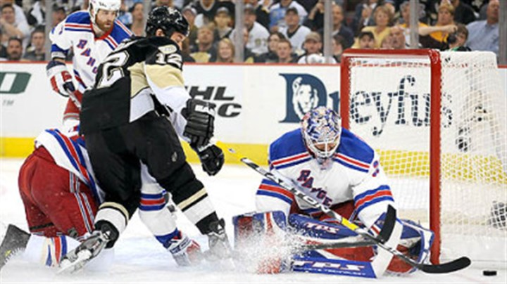 Malone Penguins Ryan Malone attempts to one hand the puck past Rangers goalie Henrik Lundqvist.