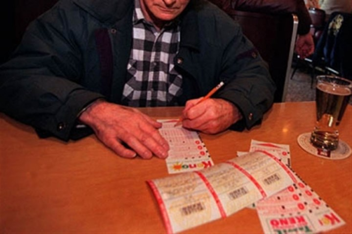 Man playing Keno in W.Va. A man fills out a Keno ticket at a bar in West Virginia.