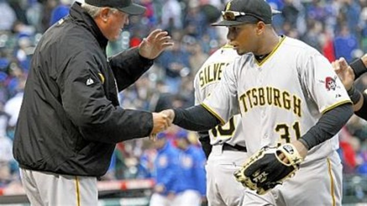 Manager Clint Hurdle and Jose Tabata Manager Clint Hurdle and Jose Tabata celebrate the Pirates' 5-4 victory Sunday against the Chicago Cubs at Wrigley Field.