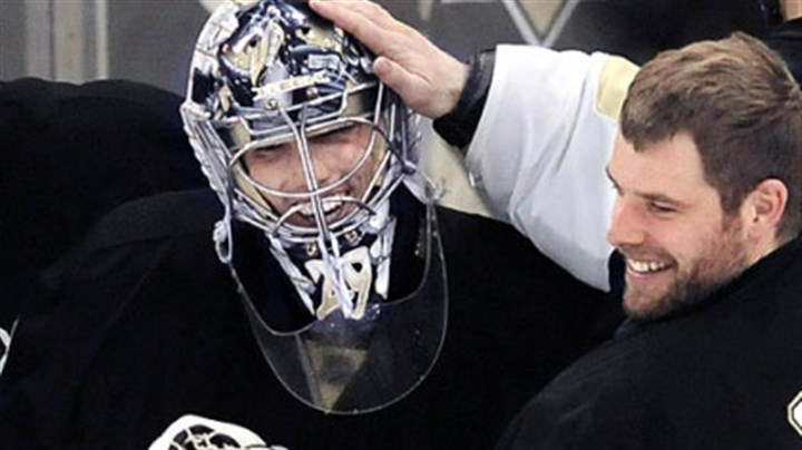Marc-Andre Fleury Backup goalie Ty Conklin congratulates Marc-Andre Fleury after yesterday's 2-0 shutout victory against the Rangers at Mellon Arena. Fleury made 26 saves to improve to 6-0 in the playoffs.