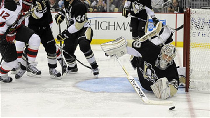 Marc-Andre Fleury Penguins' Marc-Andre Fleury dives to knock the puck away against the Islanders.