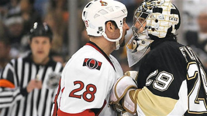 Marc-Andre Fleury faces off with Martin Lapointe Marc-Andre Fleury goes face-to-face with the Senators' Martin Lapointe in the second period at the Mellon Arena last night.