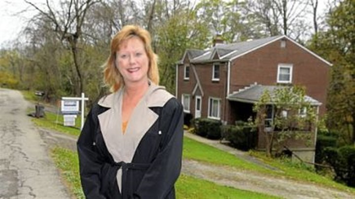 Margie Churchel Margie Churchel with one of her listed houses in Penn Hills.