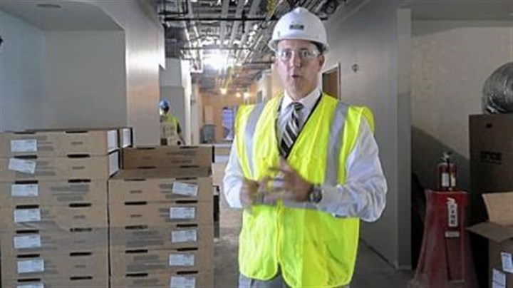 Mark Sevco, president Mark Sevco, president, UPMC East, shows a hallway in the new hospital.