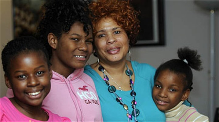 Marsha Thomas Marsha Thomas with her great-niece Nasya, 11, granddaughter Chantel, 13, and great-niece Tanoa, 9, at her home in Wilkinsburg.