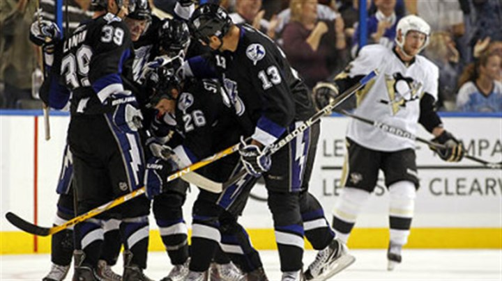 Martin St. Louis, Mike Lundin, Steven Stamkos, Pavel Kubina and Matt Cooke Lightning forward Martin St. Louis, No. 26, is congratulated on his goal by teammates, including, from left, Mike Lundin, No. 39, Steven Stamkos, No. 91, and Pavel Kubina, No. 31 as Penguins forward Matt Cooke skates in the background during the third period Wednesday's game at the St. Pete Times Forum in Tampa, Fla.