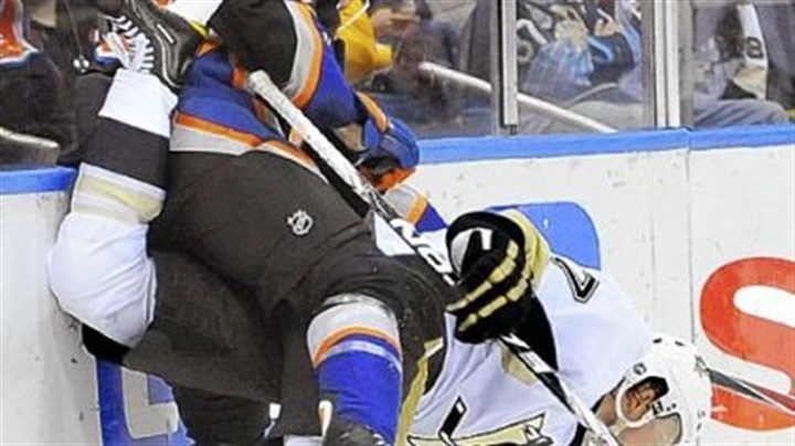 Martin Paul Martin and New York's Tim Wallace get tangled along the boards Saturday night in the Penguins' 6-3 victory against the Islanders in Uniondale, N.Y.