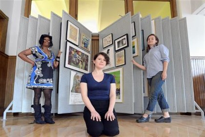 Mary Carey, Ruthie Stringer and Dana Bishop-Root From left, Mary Carey, Ruthie Stringer and Dana Bishop-Root show off part of the Art Lending Collection at the Braddock Carnegie Library, which includes 96 artworks, some by 2013 Carnegie International artists.