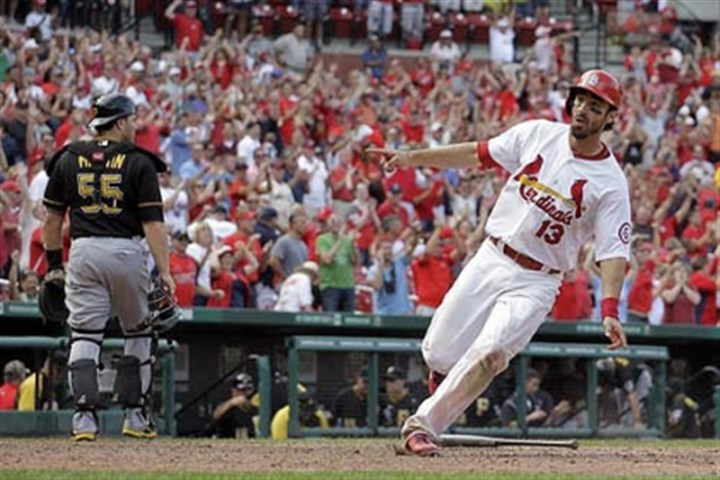 Matt Carpenter and Russell Martin The Cardinals' Matt Carpenter celebrates as he crosses the plate for the game-winning run as Pittsburgh Pirates catcher Russell Martin walks off the field during the 12th inning.