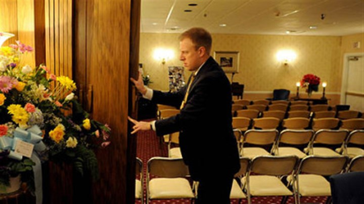 Matt Schellhaas Matt Schellhaas, supervisor of Schellhaas Funeral Home in Bakerstown,pushes back the dividers to open the chapel area as he gets ready for a funeral service Thursday morning.
