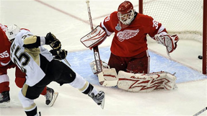 Max Talbot Penguins center Max Talbot scores against Red Wings goaltender Chris Osgood in the second period of Game 7 of the Stanley Cup Final. The game set a local television ratings record.