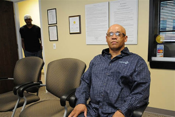 mayview grayson Norman Grayson, whose background is making his search for housing difficult, is a client at Adaptive Behavioral Services Inc. Behind him is Kevin M. Jordan, general manager and chief administrative officer of Adaptive Behavioral Services.
