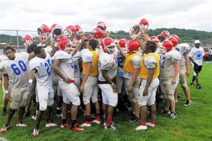 McKeesport Tigers As a show of team unity, the McKeesport Tigers huddle at the end of a preseason practice session. The Tigers welcome back former coach George Smith, who won two WPIAL and PIAA titles.