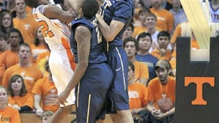 McRae Tennessee's Jordan McRae, left, tries to get a shot over Pitt's Lamar Patterson and Khem Birch, right, in the second half Saturday in Knoxville, Tenn.