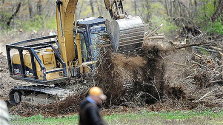 mcroberts farm Crews clear trees from a path that will become a gravel road leading toward a Marcellus shale pad site on the property of the McRoberts family of Darlington Township..