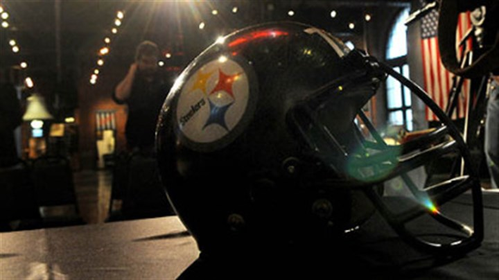 "mean joe green helmet Under the bright lights is the helmet used by the Steelers' No. 75 ""Mean"" Joe Greene. The helmet is part of the display of artifacts from the Pro Football Hall of Fame at the Heinz History Center."